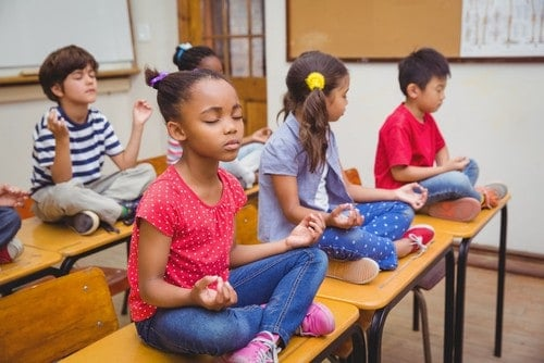 kids meditating in school