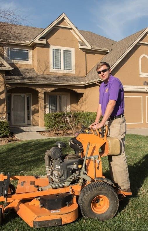 Employee on standing mower