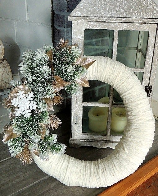 This simple DIY winter wreath is made with yarn and festive winter accents