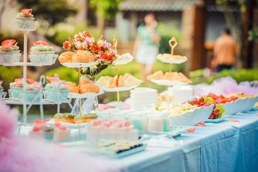 an event table filled with a beautiful spread of food