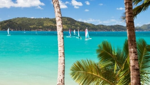 Bright blue ocean with small sailing vessels in the Whitsundays, view from Hamilton Island