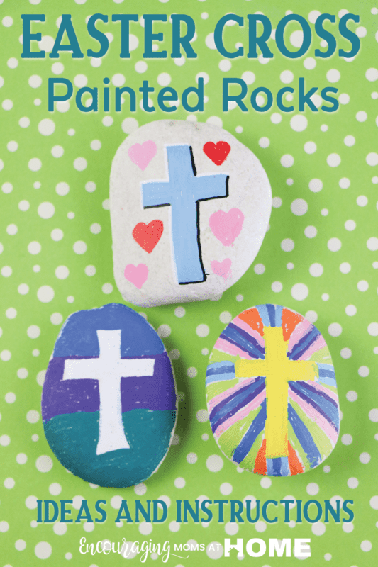 Three rocks decorated with cross images for Easter.