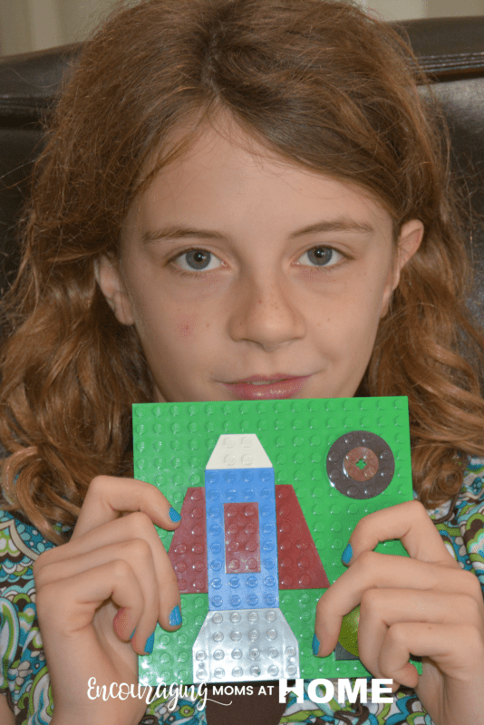Anna, age ten, displays her LEGO Art.