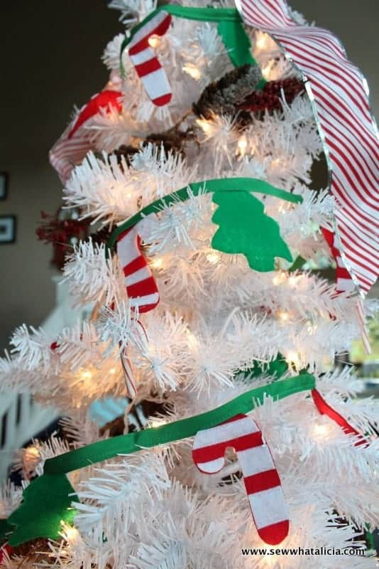 white christmas tree with candy cane and tree garland