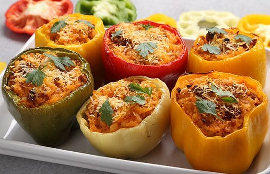 Spicy stuffed bell peppers in a white dish