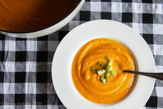 butternut squash soup on a black & white check napkin
