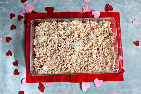 crisp rice cereal treats in a glass 13 x9 dish on red felt