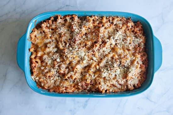 Chicken Parmesan Macaroni Bake in blue baking dish