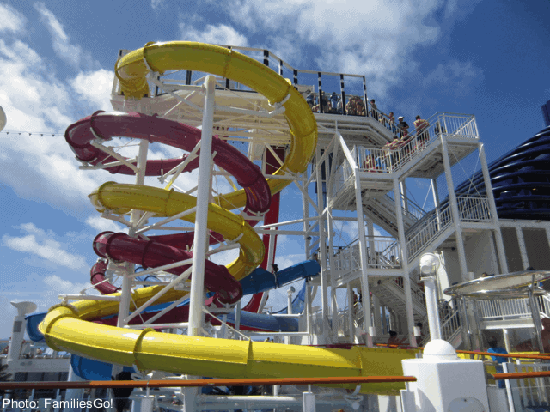 Norwegian cruies ships have fun water slides, like these red and yellow ones that twist around each other.