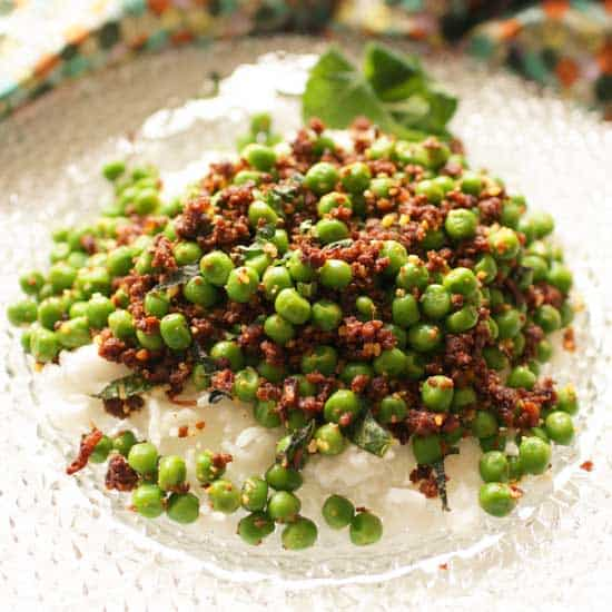 Spicy Chorizo Peas on a glass plate