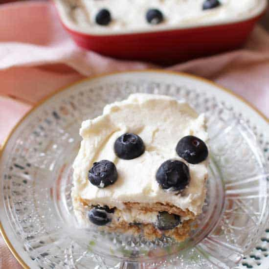 slice of icebox cake on a plate with berries