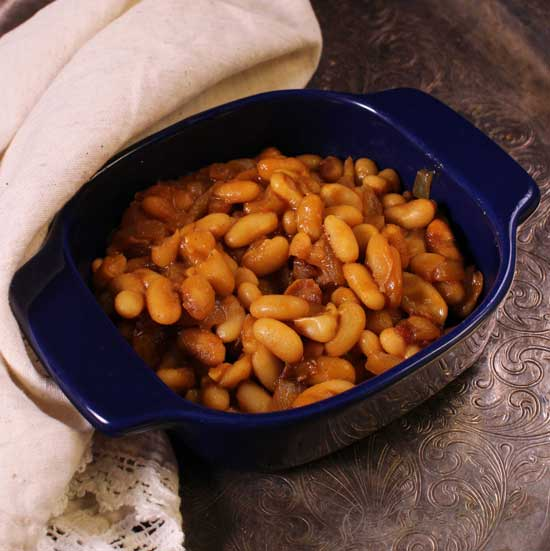 a bowl of baked beans with bacon.