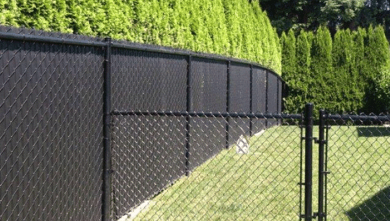 Chain links fencing is strong and durable and the metal material can last a very long time on any property! Chain link is typically much more affordable than most other fence types and provides great security to any property.