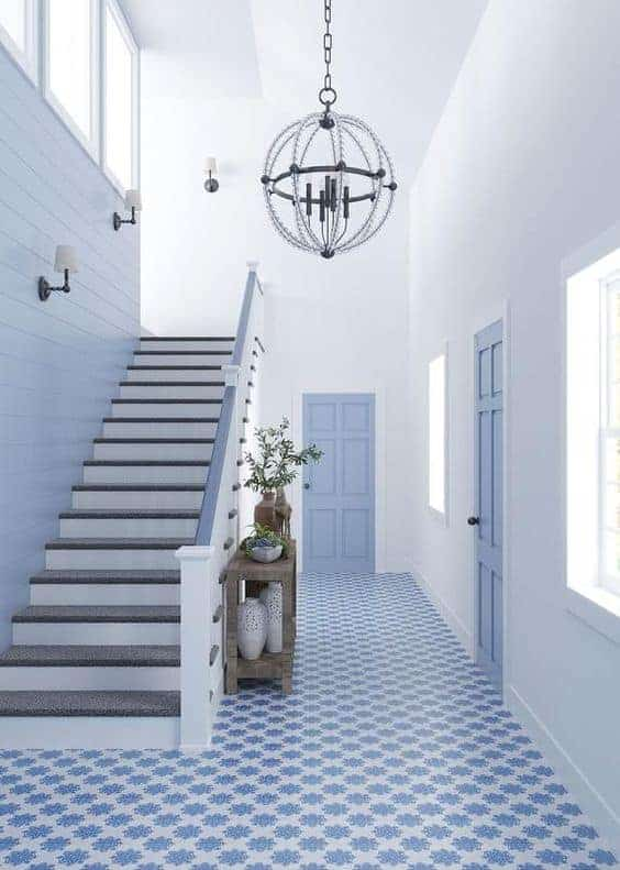 blue and white mosaic tiles for entrance hallway with white walls and blue doors