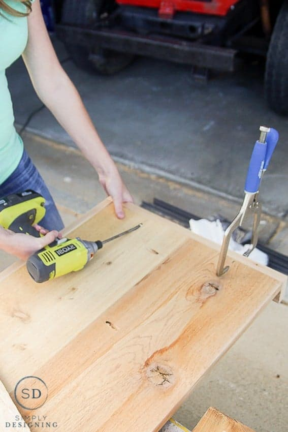 "Using Ryobi Drill to secure 1x3"" sides to 3 sides of each shelf for the printer table using pocket holes"
