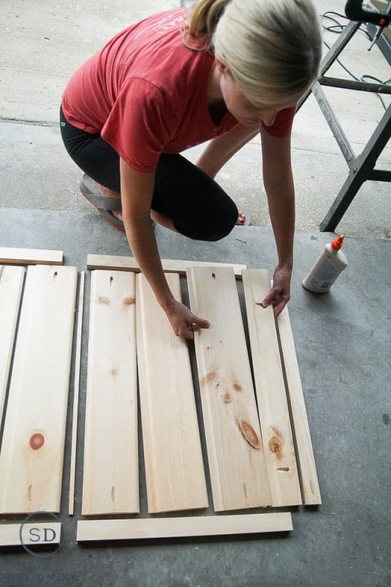 Locking boards together with wood glue to make a DIY Baby Gate