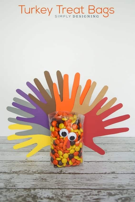 Handprint Turkey Treat Bags - these simple treat bags are so fun for kids to be involved in creating