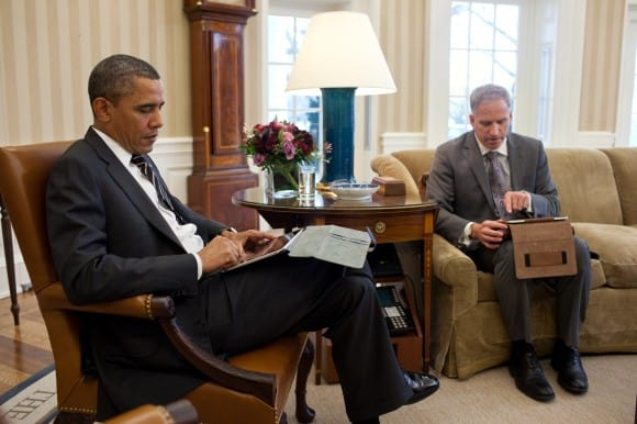 Obama receives briefing on an iPad