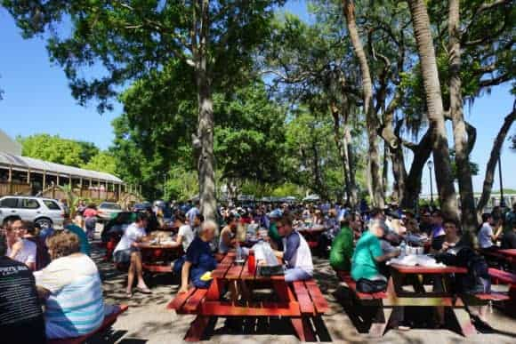 The Tampa Buddhist temple's Thai brunch is eaten at shady picnic tables overlooking the water. (Photo: Anna Blasco)