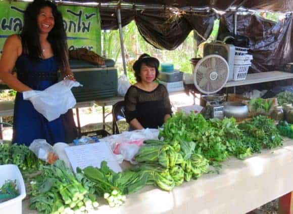 The Sunday market at the Tampa Buddhist temple includes booths sellingvegetable and herbs.