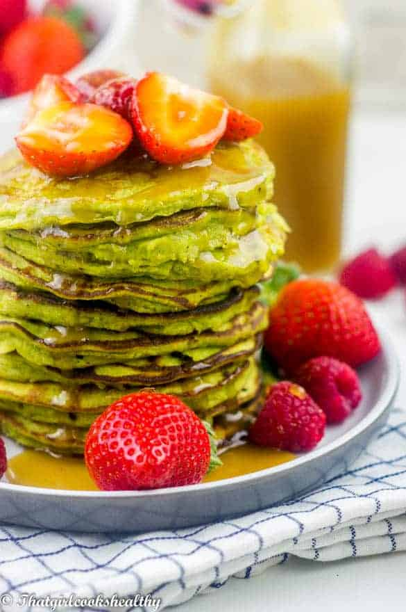 Gluten free spinach pancakes drizzled with ginger syrup