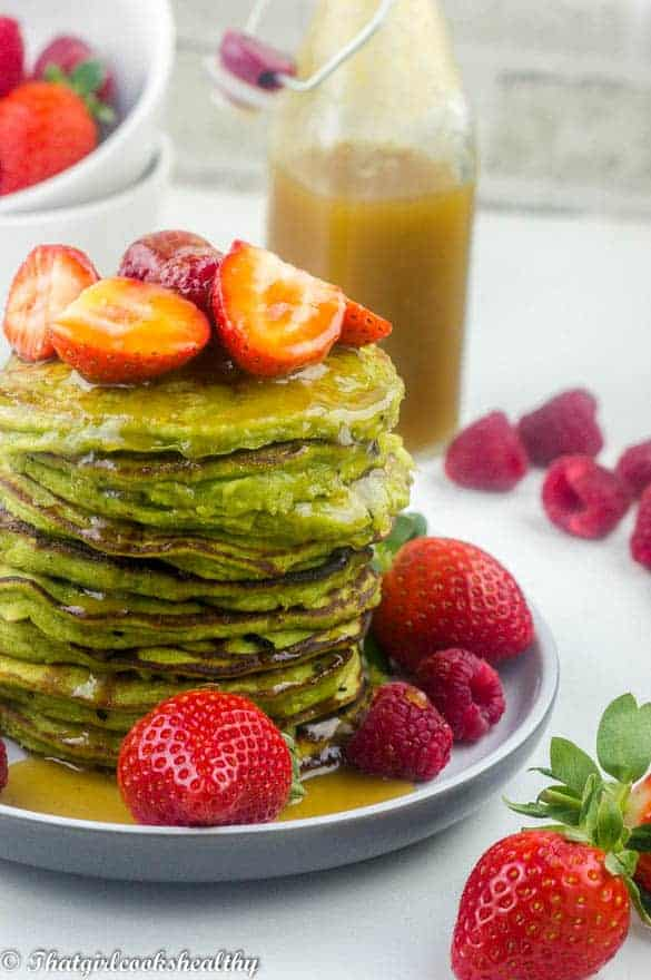 Gluten free spinach pancakes with ginger bottle behind