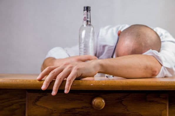 male dealing with alcohol use disorder