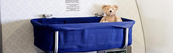 airplane bassinet, airline bassinet, garuda indonesia bassinet, which airlines have bassinets for infants