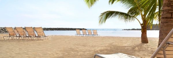 The Embassy Suites resort in Dorado, Puerto Rico has a beach with calm water protected by a sea wall.