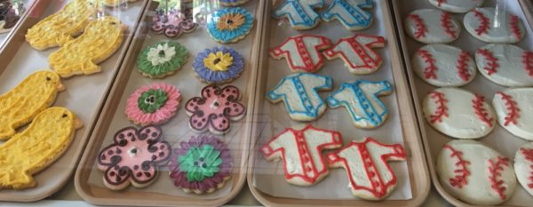Sugar cookies look like yellow chicks, spring flowers, baseballs and baseball jerseys in the window at Schneider's Bakery in Cooperstown.