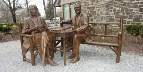 A jovial franklin and eleanor roosevelt (statue) welcome visitors to their dutchess county estate, hyde park