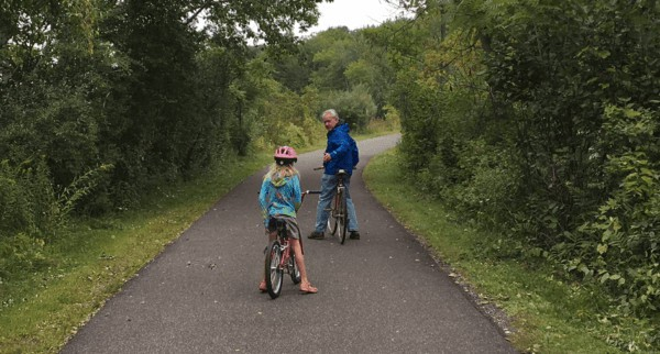 A dad and daughter pause in the bicyle ride on the  Ashuwillticook Rail Trail in the Berkshires