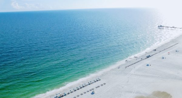 Gulf Shores has a long stretch of beach with good sand and calm water.