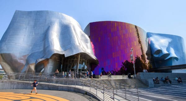 Seattle's museum of pop culture is in a building that looks like 3 inverted metal cups, a distinct, frank gehry design.