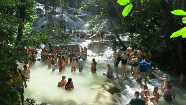 Lots of tourists enjoying dunn's falls in jamaica