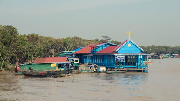A floating church and other buildings in a floating village on tonle sap in cambodia.