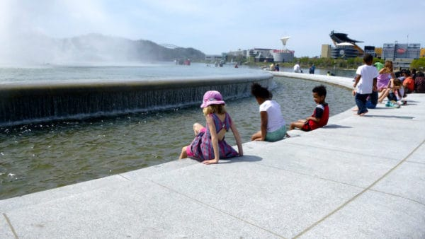 The fountain at point state park attracts kids for splashing while parents take in views that include the city's stadiums.