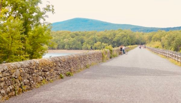 The ashoken rail trail is a popular hiking and biking spot for a weekend getaway to the hudson valley.