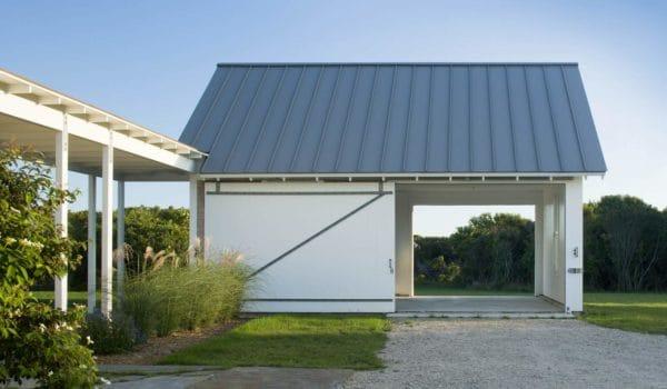 pair a massive sliding barn style garage door in crisp white with englert slate gray metal roof