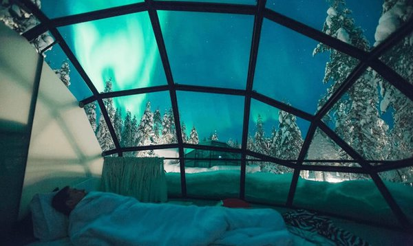 A snug way to see the northern lights, in a glass igloo in finland