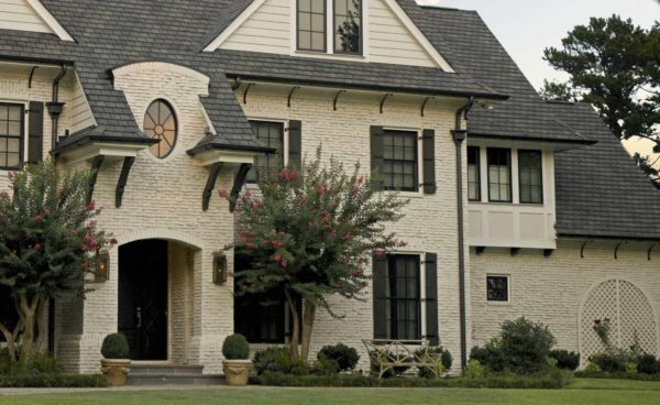 painted brick house in shell white and black bronze color windows