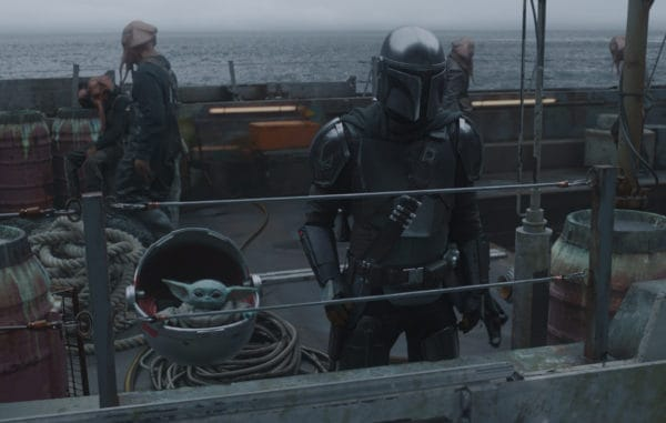 Baby Yoda and The Mandalorian on a Boat