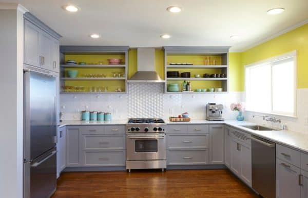 u-shaped kitchen with chartreuse backsplash and turquoise accessories
