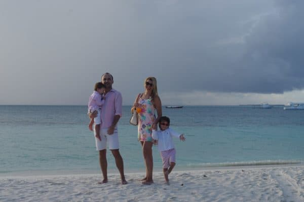 Enjoying cocktails on the beach while exploring Maldives with kids