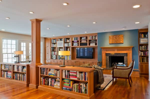 bookshelf half wall room divider for a traditional and cozy family room