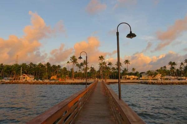 The list of things to do in Islamorada starts with admiring the sea and sky. This is dawn at the pier at the Islander Resort, a classic Islamorada hotel.