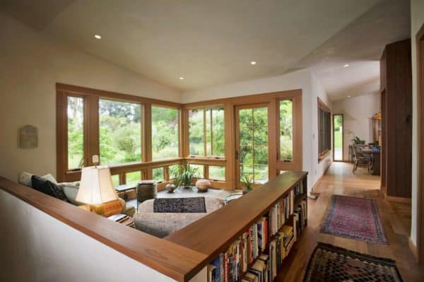 l-shaped bookcase half wall room divider to enclose a cozy hang-out nook
