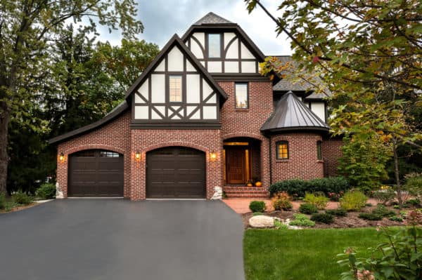 mix metal and traditional gable roof with your red brick exterior for a classic and charming home