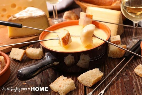 fondue on counter with cheese and bread