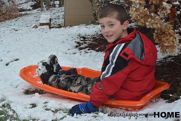 Joshua Waits his turn on the sled